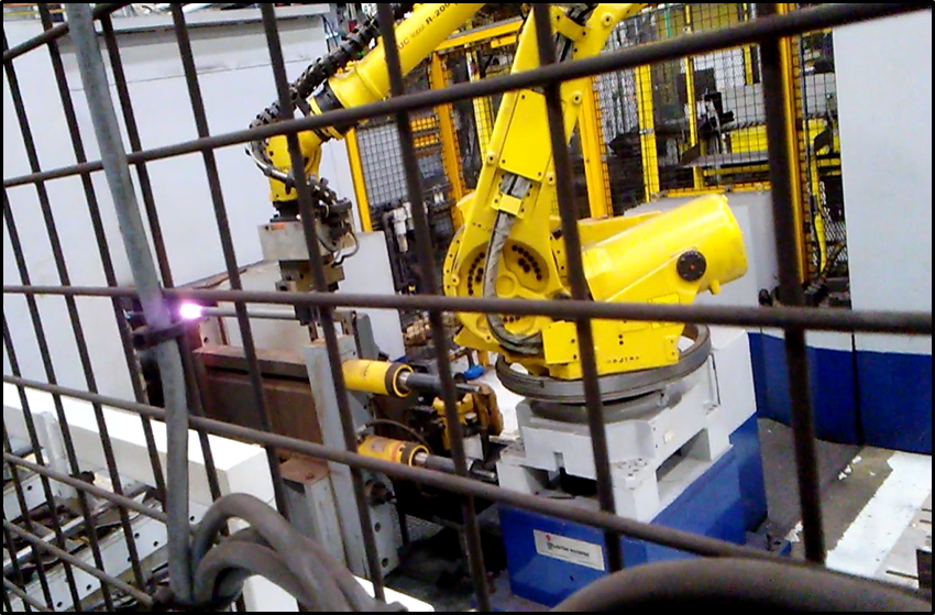 robot moving steel to an induction heating coil